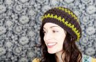 stock photo of a young woman wearing a handmade beret style hat; smiling